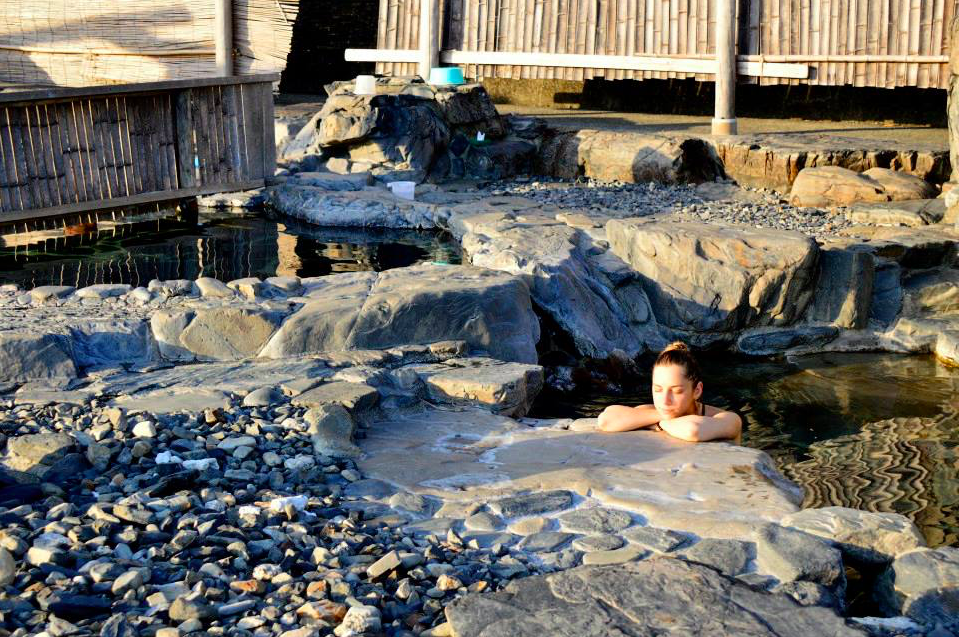 a woman in natural hot springs